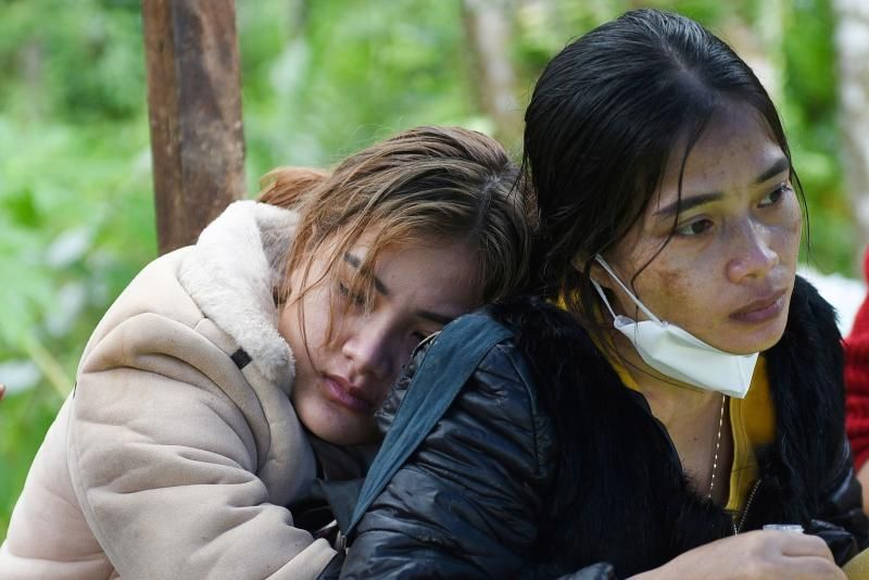 Ho Thi Hoa (resting on her relative's shoulder after some of her family members were buried in the landslide in Nam Tra My district, Quang Nam province on Friday (Oct 30). - Reuters