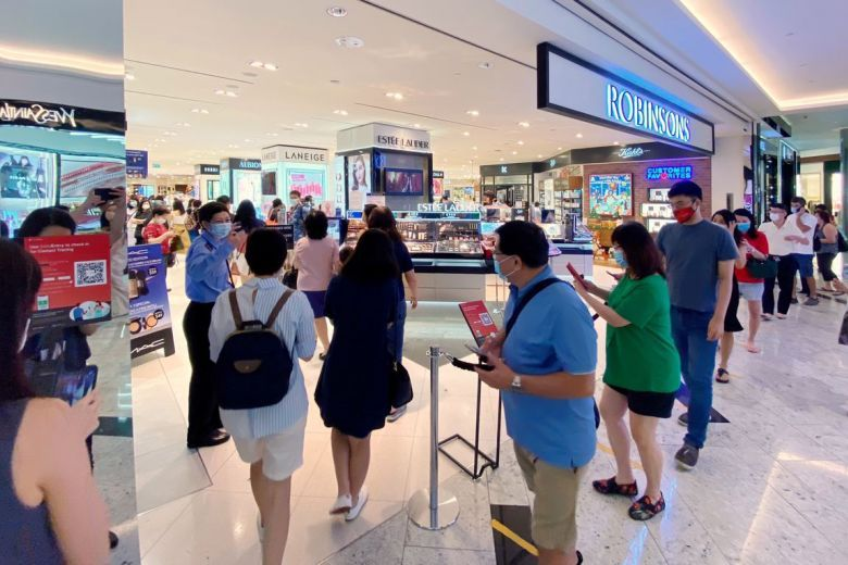 Shoppers visiting the Robinsons store at Raffles City on Friday (Oct 30, 2020). - The Straits Times/ANN