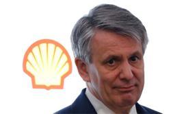 Shell raises dividend, cuts 9,000 jobs
