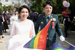 'Coming out bravely'- Taiwan same-sex couples join military wedding for first time