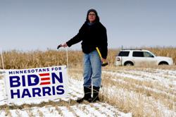 Biden farms for crucial votes in Trump Country