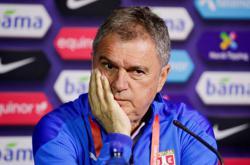UEFA suspend Serbia coach, fine FA for delayed kick off