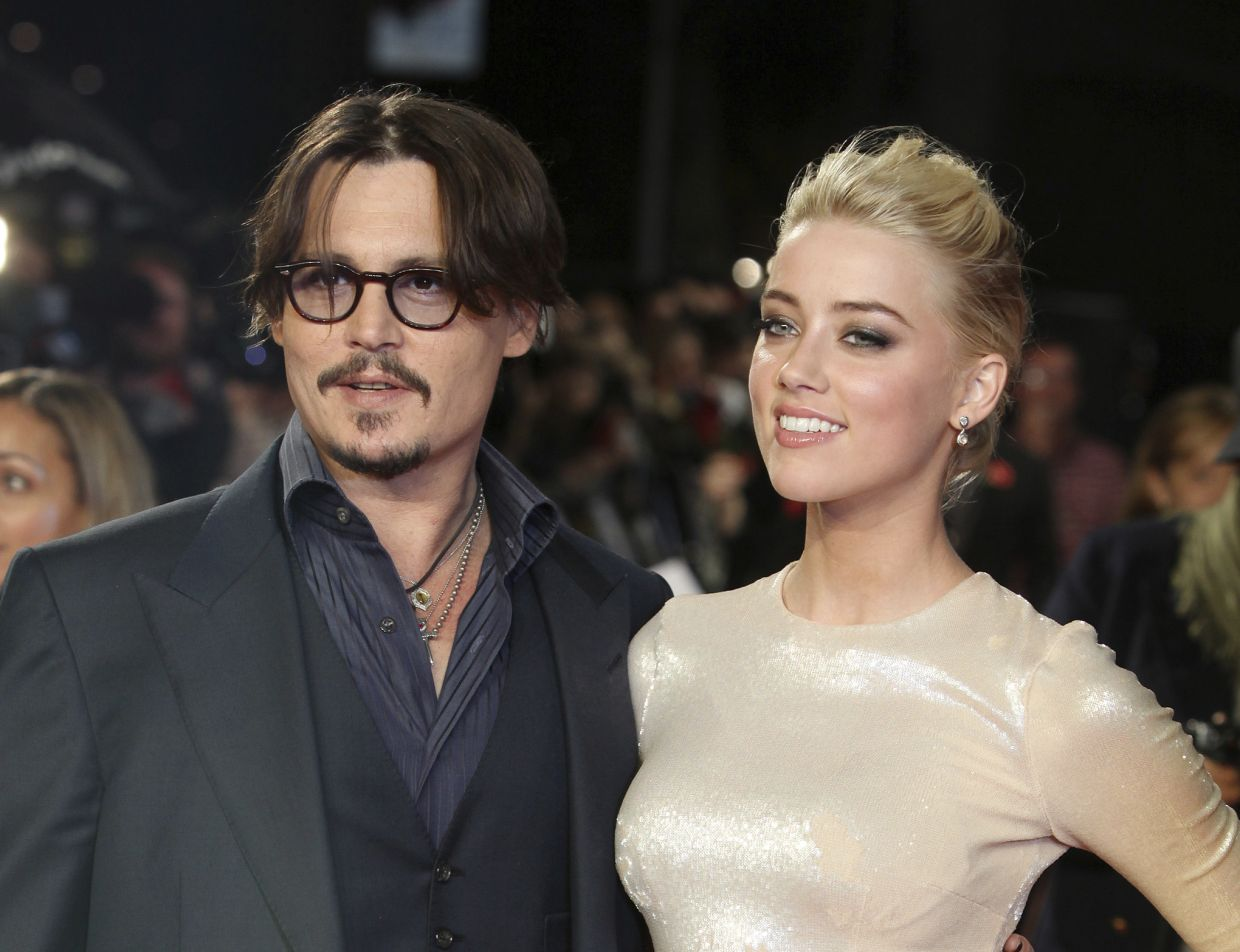 A Nov 3, 2011 file photo of US actors Johnny Depp (left) and Amber Heard arriving for the European premiere of their film, 'The Rum Diary', in London. Photo: AP