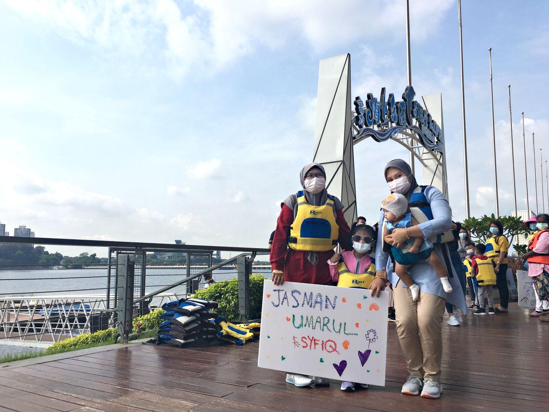 (From right), Ezatul carrying her baby daughter Nadeeraa Hayfaa, Amanda (whose parents are in Singapore), and  Ezatul's sister, Hayatul Aqmal (whose husband is in Singapore). Photo: Ezatul Hani