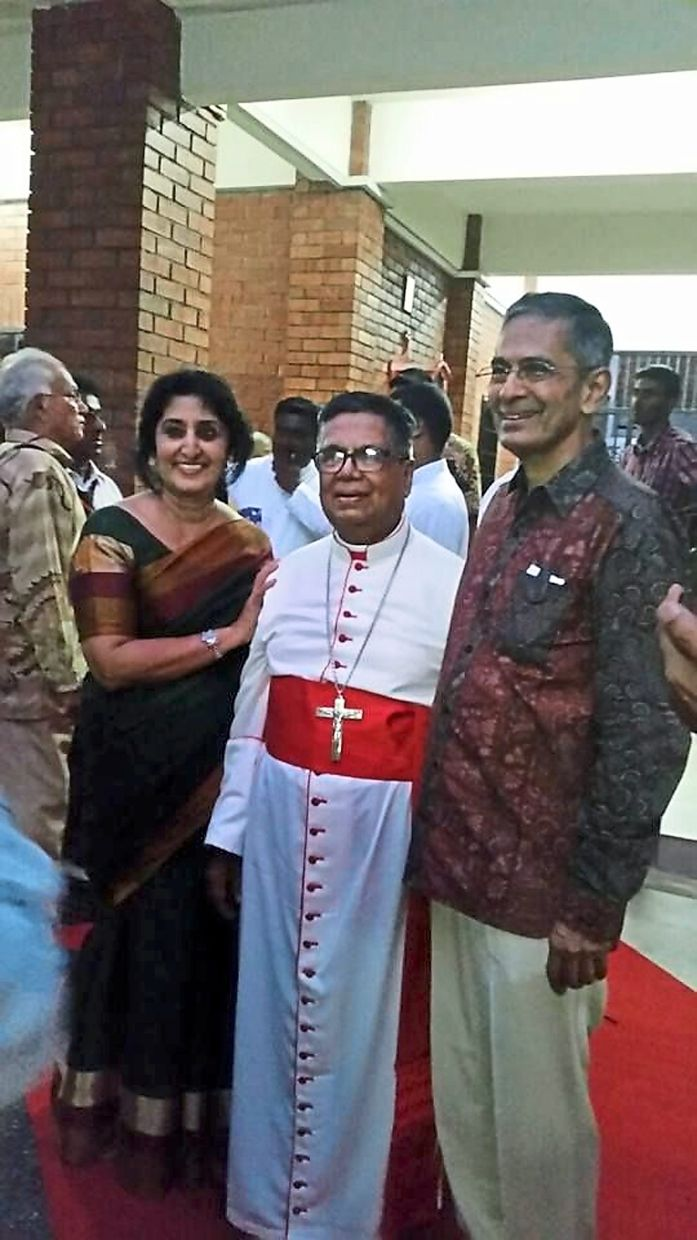 Rev Fernandez flanked by the writer and her husband Dr Hari Dass.