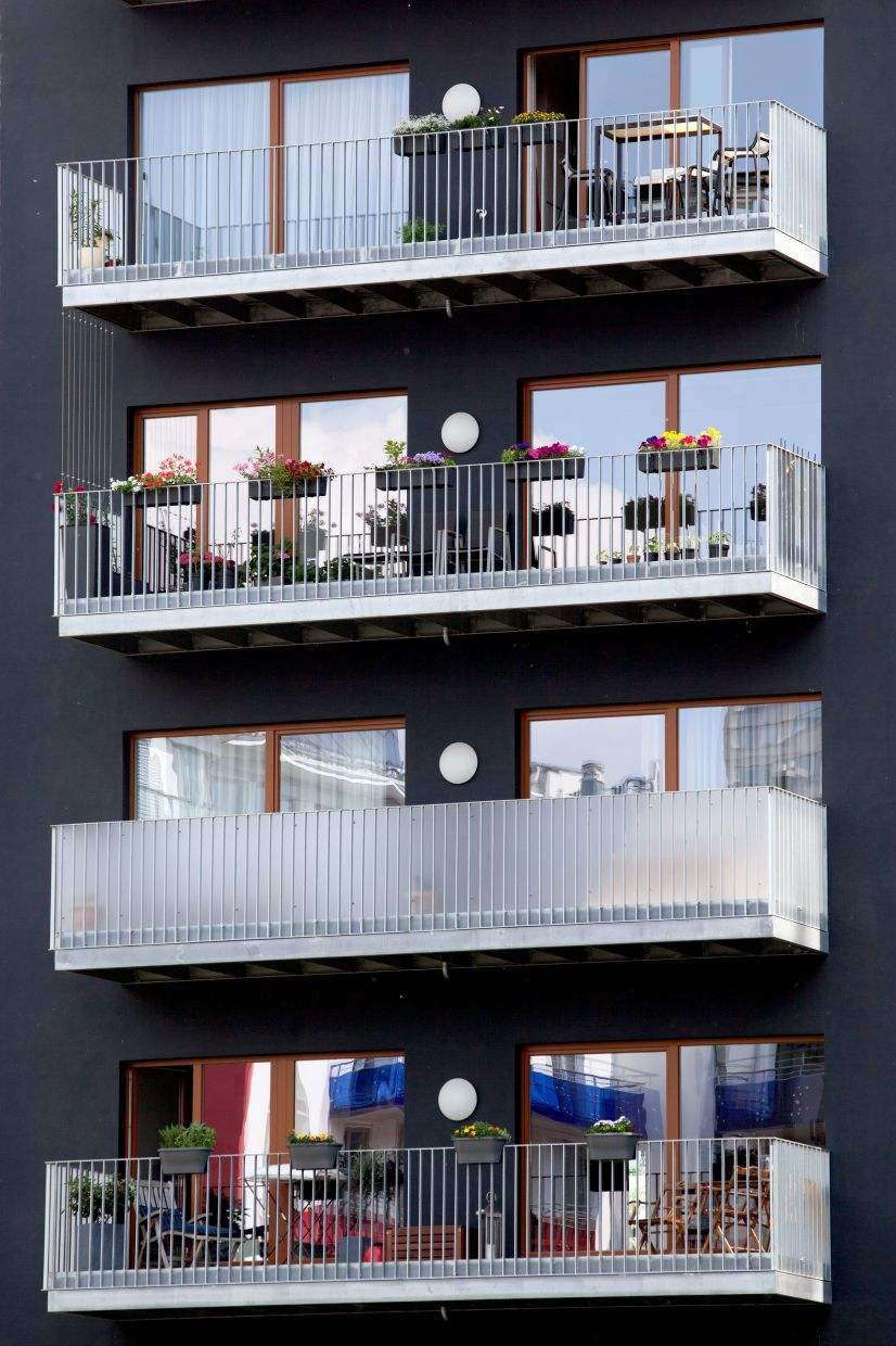 Wide sliding windows make access to the balcony easy.