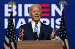 Biden wins Michigan and Wisconsin, now on brink of White House