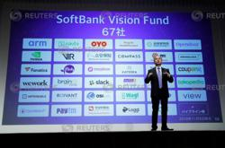 SoftBank books $1.3 bln loss from tech stock speculation