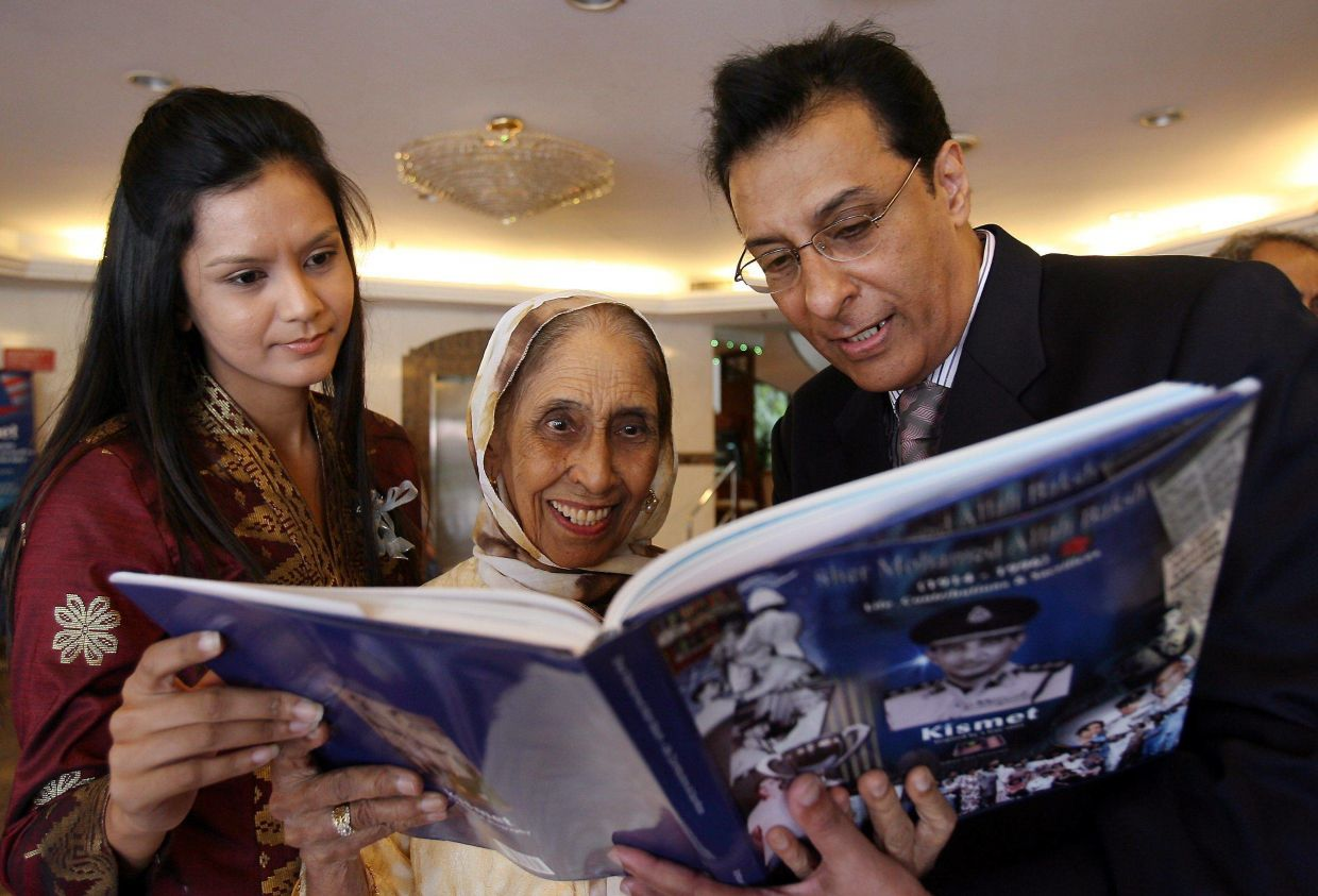 Rafique Sher Mohamed (right) with his mum Che Rash Bibi Rahmad Ali (wife of Sher Mohamed) and granddaughter Tania Zubir after the book launch. File photo: The Star/Art Chen