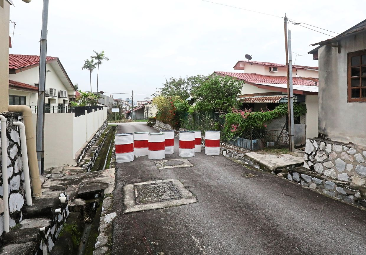 Some residents in Petaling Jaya are against blocking roads with barriers such as these drums. — Filepic