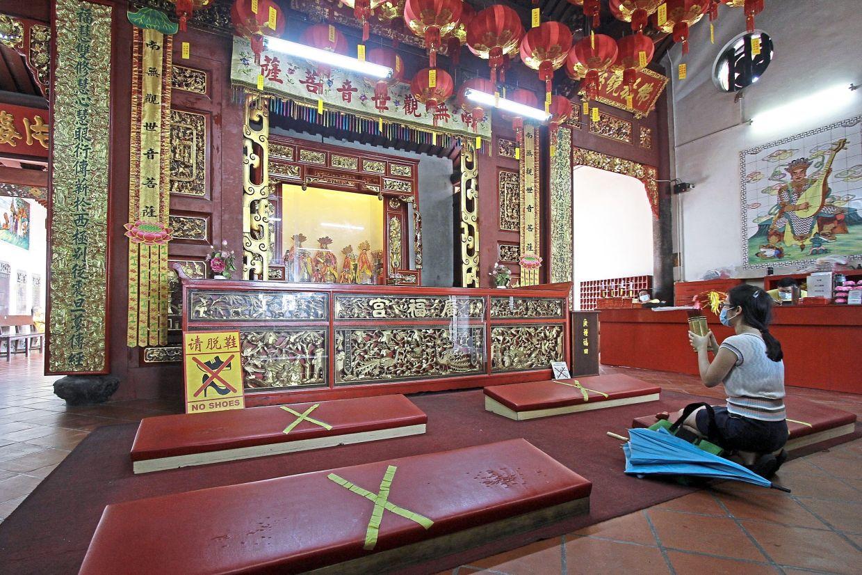 Physical distancing markers placed at the Kuan Yin Temple in Jalan Masjid Kapitan Keling, George Town.