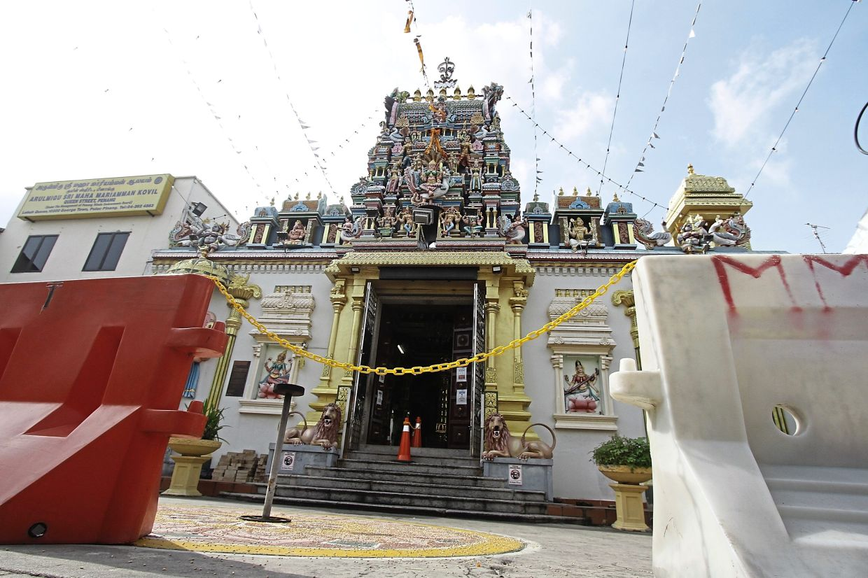 Only a maximum of 30 visitors are allowed to enter a temple at any one time for Deepavali prayers depending on the size of the place. Seen here is Sri Maha Mariamman Temple in Penang.