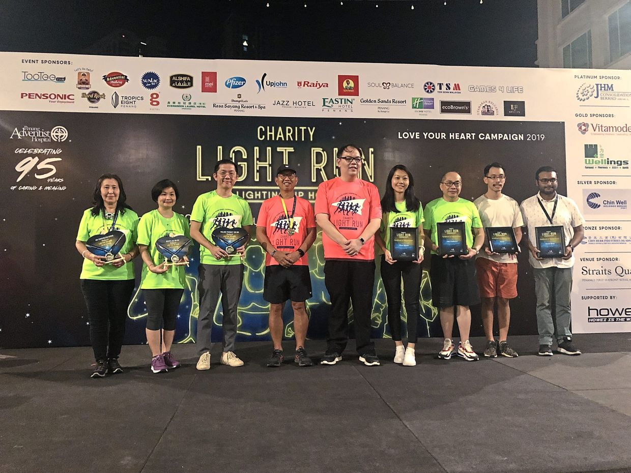 Doing it right: As part of its corporate social responsibility efforts, JHM backed Adventist Hospital's Charity Light Run in 2019