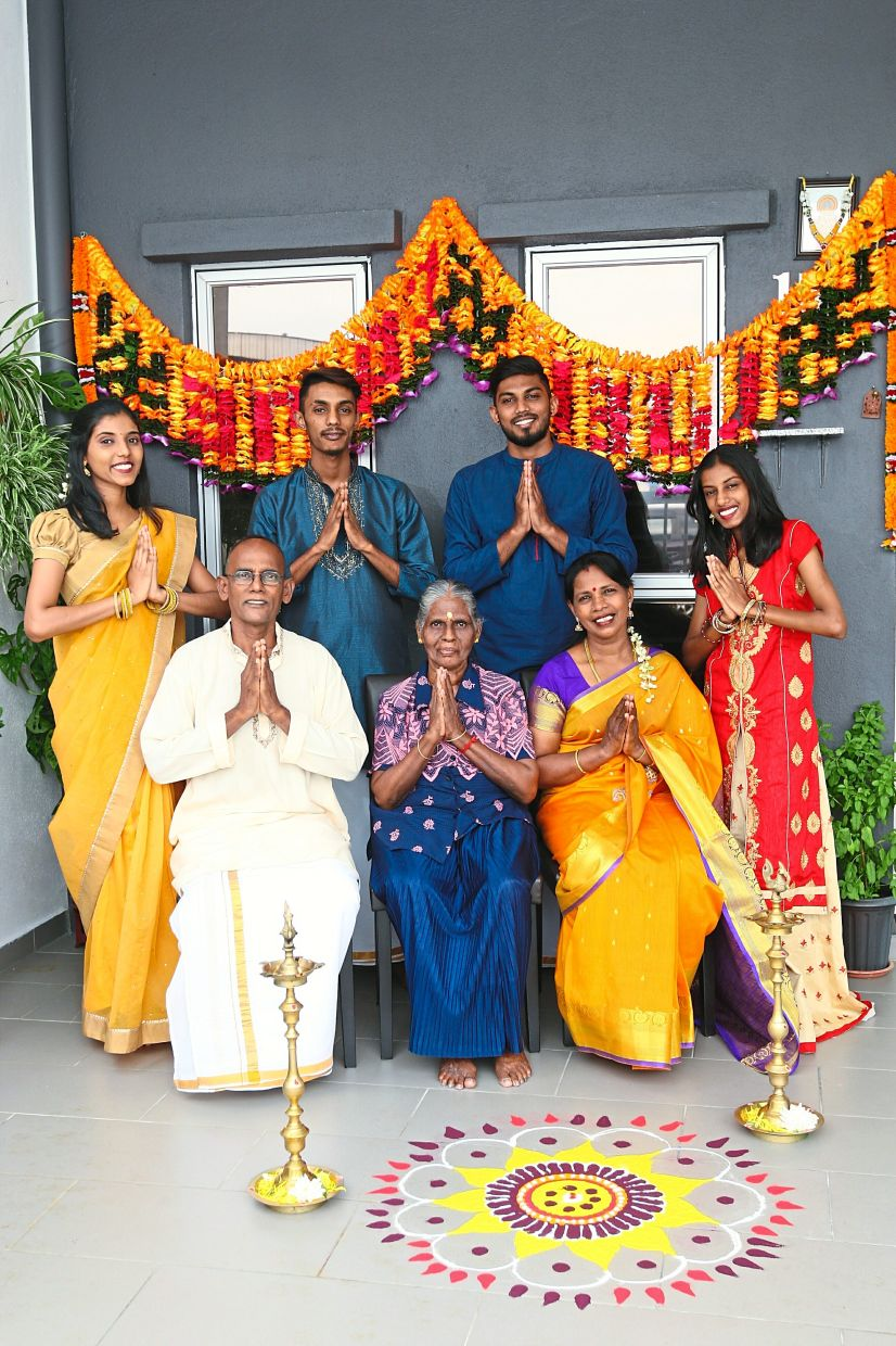Mathavi and Krisnan's family of seven are.grateful that they can celebrate Deepavali together. Photo: The Star/Azman Ghani