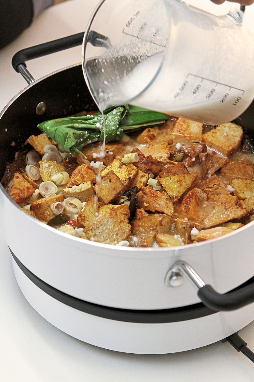 Pour in the santan and then add ½ to 1 cup of water, depending on the gravy consistency you want.