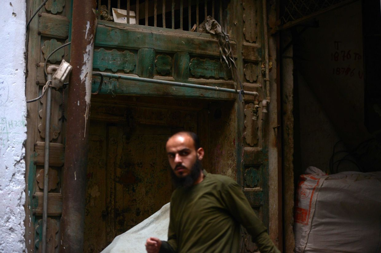 Kumar lived in a simpler home down a small lane in a busy market, its entrance faded and its roofless interior heavily damaged. Photo: AFP