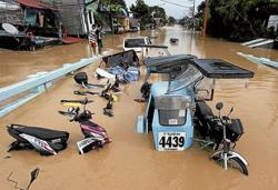 Philippines sees death toll in typhoon floods, landslides rising to 39