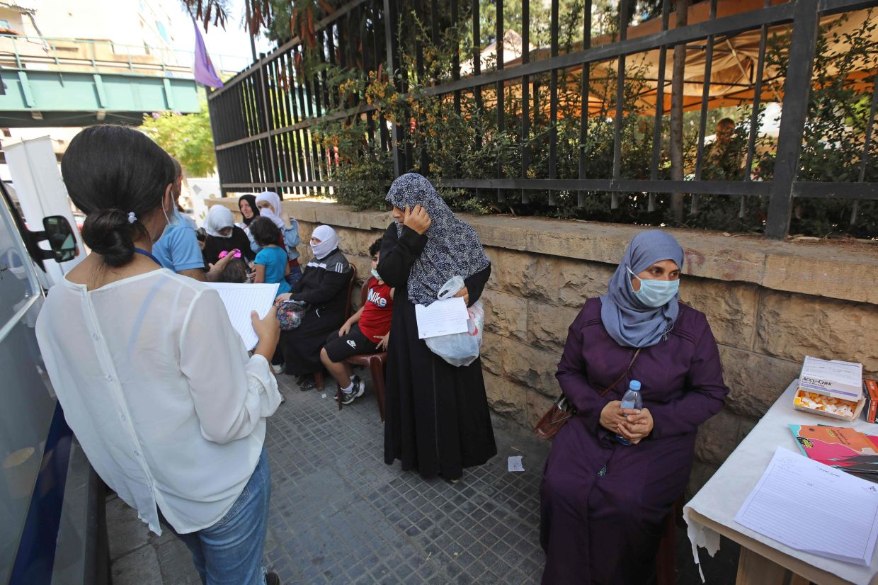 Old women are often left in poverty. Lebanon has one of the world's lowest rates of women in the workforce, with less than one in three in paid employment, according to UN Women. File photo: AFP