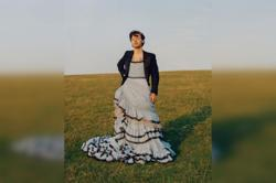 Singer Harry Styles first man on the cover of Vogue; wears ball gown