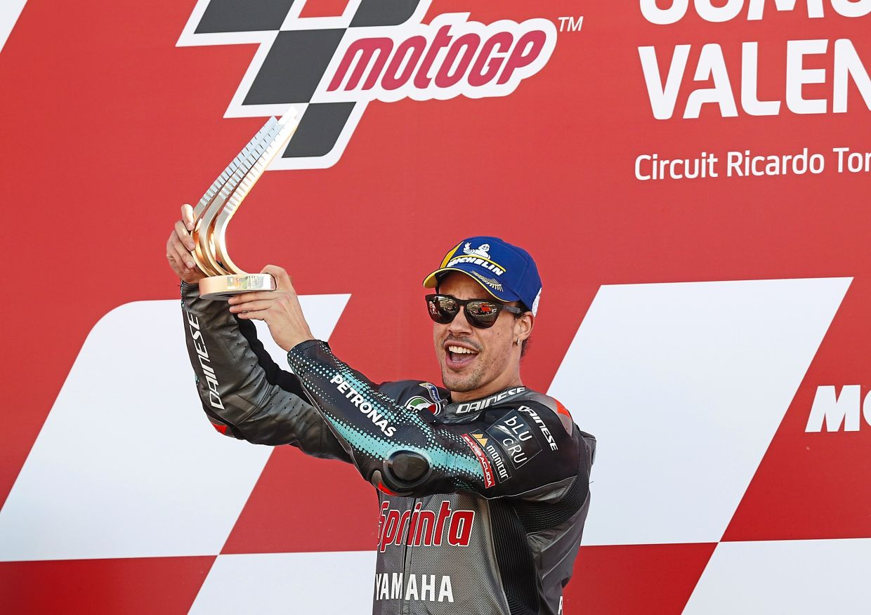 Morbidelli celebrating with the trophy after the suspenseful win. — AFP