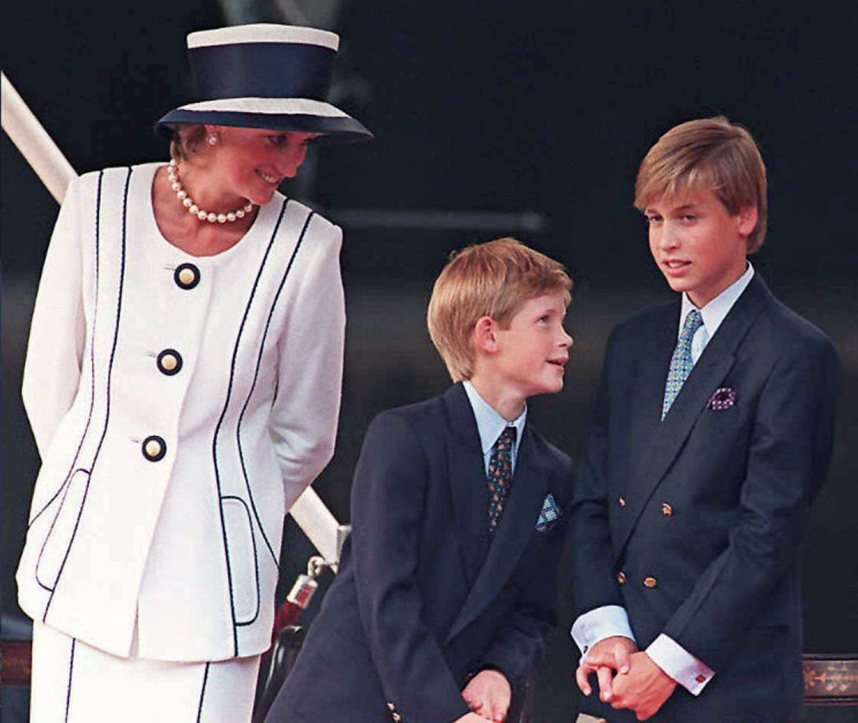 This file photo taken on Aug 19, 1995 shows Princess Diana and her sons Prince Harry (centre) and Prince William, as they gather for the commemorations of VJ Day in London. Photo: AFP