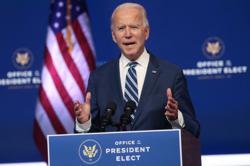 China's securities regulator hopes China-US ties better with Biden