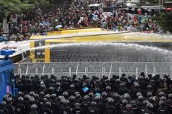 Thai police fire water cannon at Parliament protest
