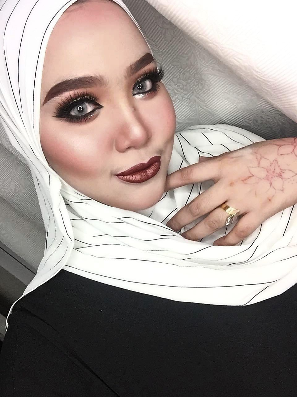 Mimie Aziz, who is cherishing this downtime to care for her baby boy, says she will resume offering her makeup services when things get better. — Photo: Mimie Aziz