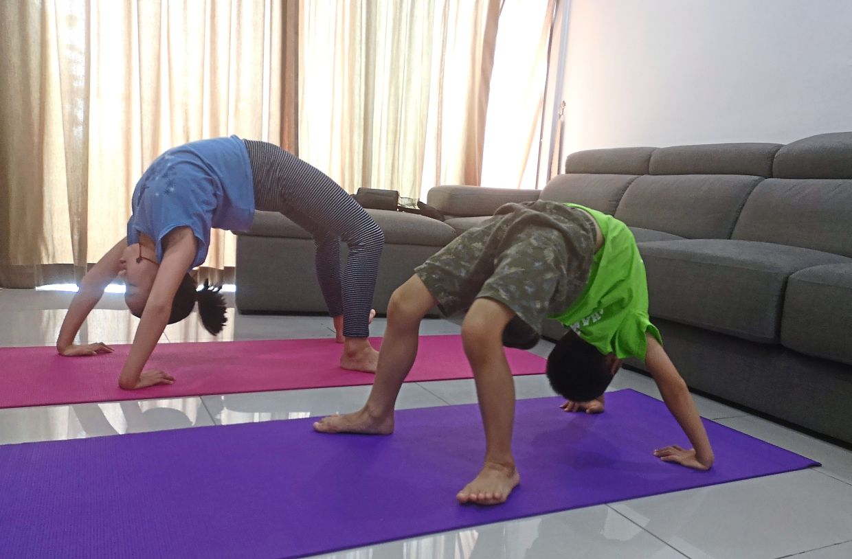 Pei Xin and her brother Min Yi, eight, exercising at home. They also stay active by trying out new recipes every day with their mother's help.