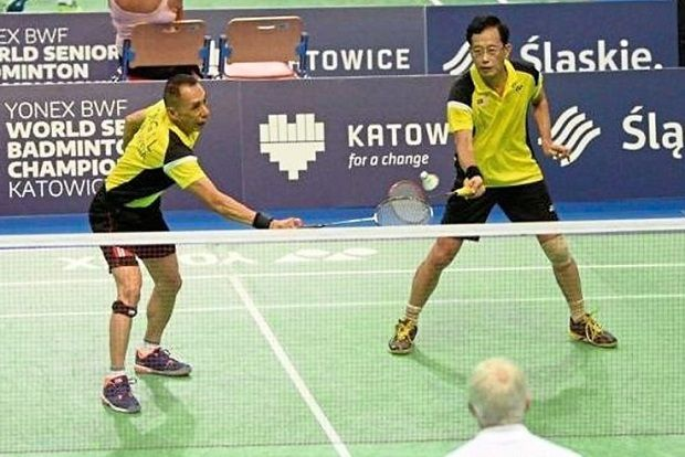 The seniors still rock: Ong Then Lin (left) returning a shot to the opponent while Wan Seong looks on.