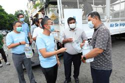 Residents receive drinking water