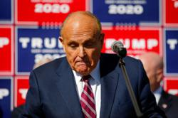 Oh dear: Rudy Giuliani does his 'Four Seasons' act, but this time in court