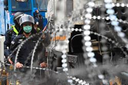 Protesters mass despite violence