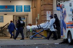 As COVID-19 cases soar, New York City schools halt in-person classes