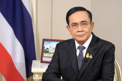 Thai PM says all laws to be used against protesters