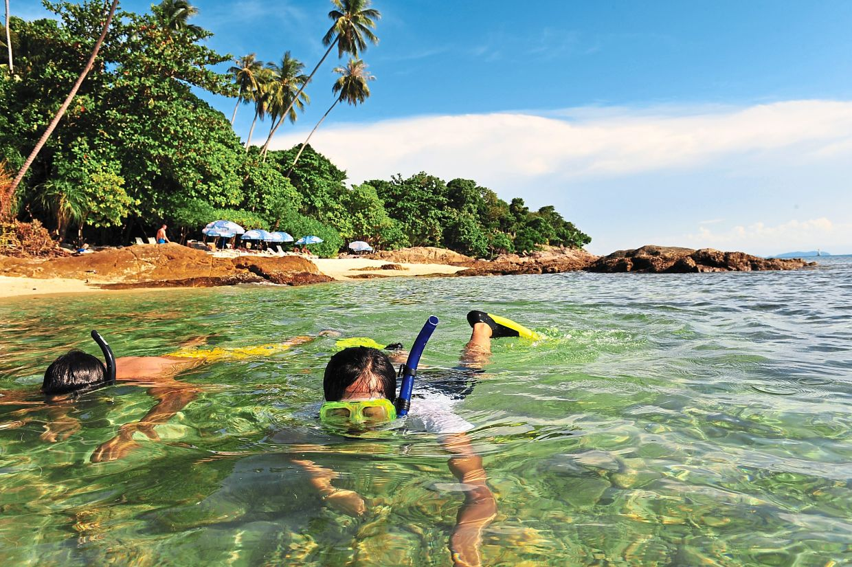 Snorkelling and scuba diving are popular activities in Perhentian island, Terengganu. — Photo courtesy of Tourism Malaysia