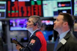 Wall Street closes higher as new stimulus talks ease shutdown worries