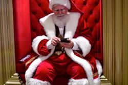 Santa, barred from malls and chimneys, enters homes via interactive video