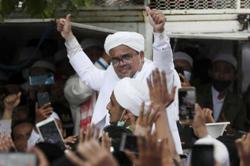 Hardline cleric's return from exile unlikely to stir Muslim rage in plural Indonesia