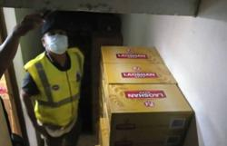 Sundry shop owner nabbed for possessing contraband cigarettes, liquor worth over RM44k