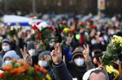 With applause and flowers, thousands attend funeral of Belarusian protester