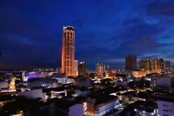 Penang's Komtar glows in sparkling orange as Covid-19 cases ease in the state