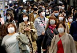 Japan health experts urge pause in domestic travel campaign as COVID-19 cases surge