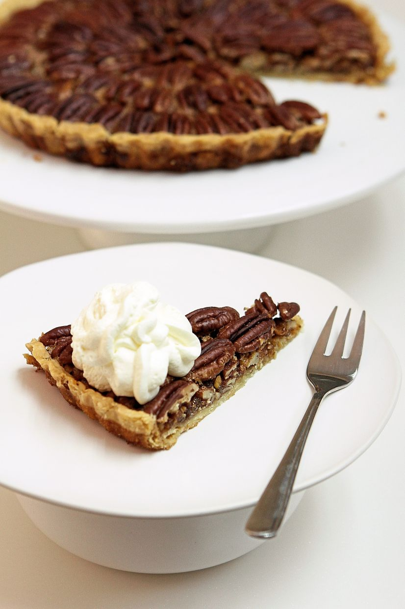 Pecan pie is traditionally served with a dollop of whipped cream for Thanksgiving.