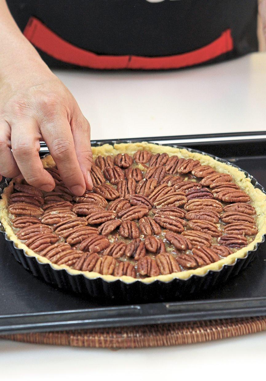 Reserve whole pecan halves to decorate  the top of the pie.