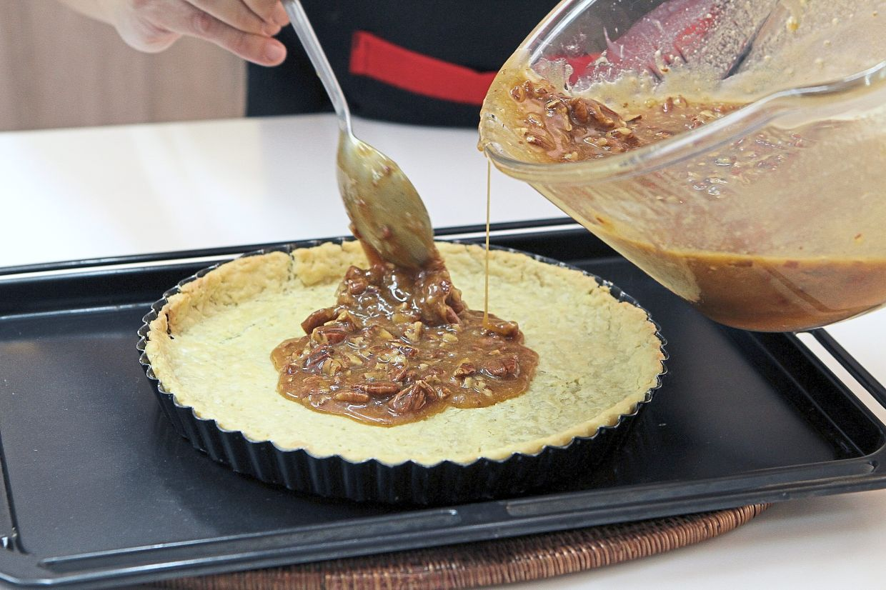 Fill the baked pie crust only after it has  cooled down or the hot crust will absorb all the liquid.
