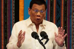 Philippines' Duterte ends overseas travel ban on healthcare workers, minister says