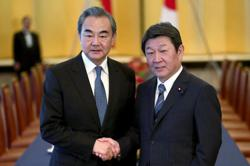 China's Foreign Minister Wang to meet Japan's PM Suga next week