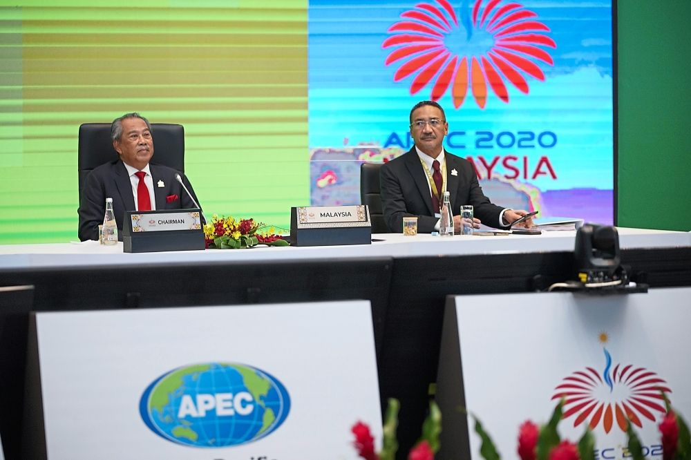 Meeting peers: (From left) Muhyiddin and Foreign Minister Datuk Seri Hishammuddin Hussein waiting to give opening remarks at the virtual Apec leaders' summit in Kuala Lumpur. — AP
