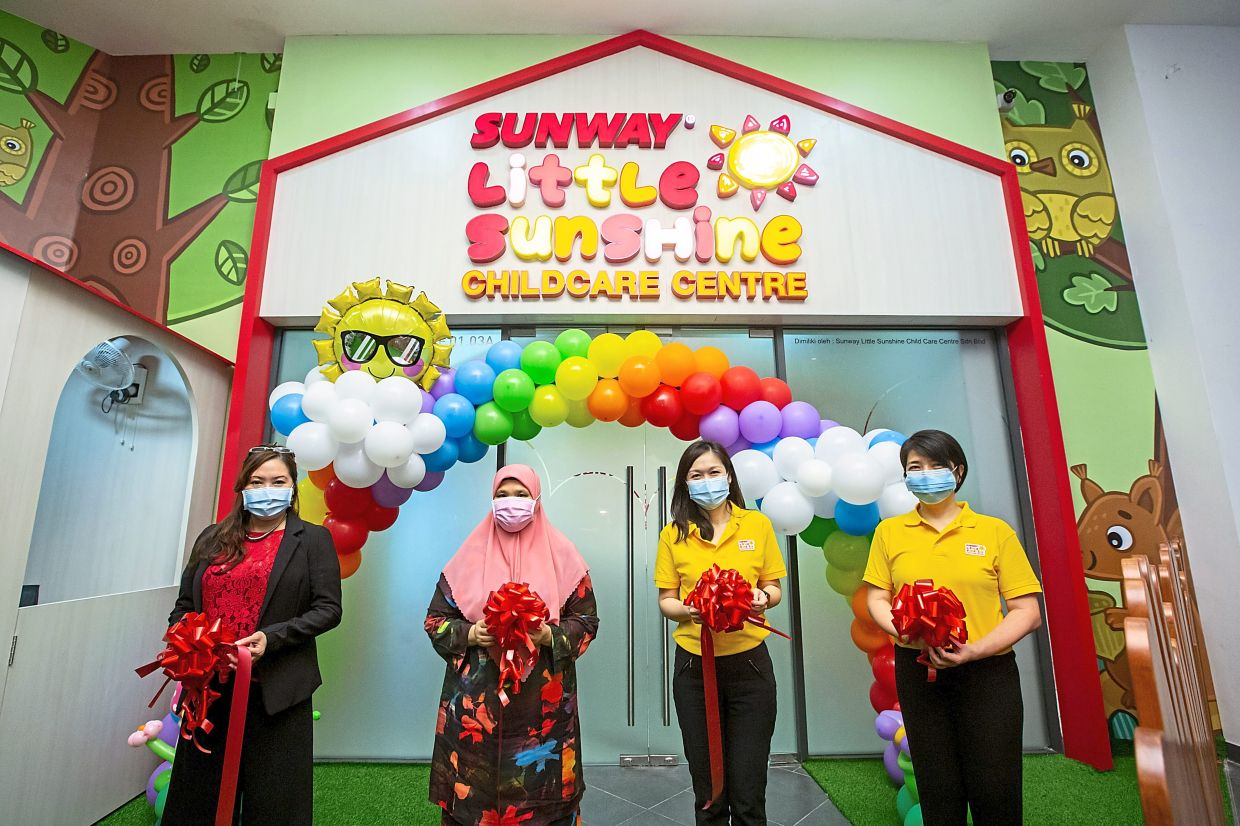 Sunway Bhd executive director and Sunway Property managing director Sarena Cheah (second from right) and Foo (right) at the launch of Sunway Little Sunshine Childcare Centre at Sunway GEO in Petaling Jaya.